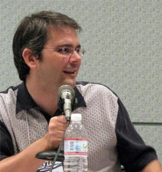 "Steven Melching speaking on a panel at the Screenwriting Expo in L.A. in 2008. Melching has written for ""The Clone Wars"" and ""Transformers Prime."""