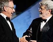 Steven Spielberg, left, presents the lifetime achievement award to George Lucas at the American Film Institute's Life Achievement Awards. / Getty Images